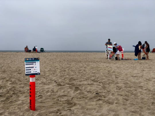 Cones are set up along Port Hueneme beach so that beachgoers know where they can safely sit without violating social distancing on Monday, May 25, 2020.