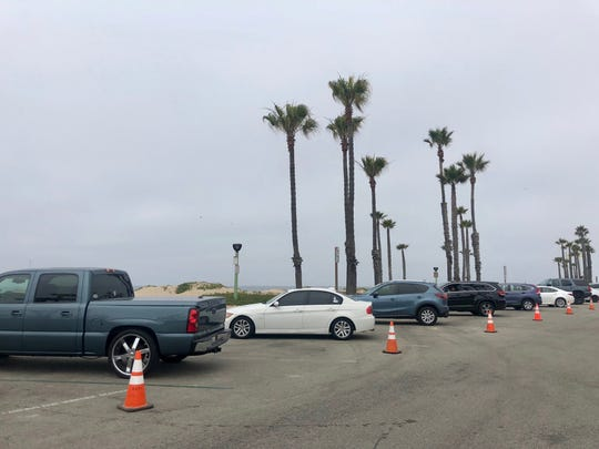 At Port Hueneme beach, cones are in every other parking space to ensure cars park far enough apart to allow for social distancing on Monday, May 25, 2020.
