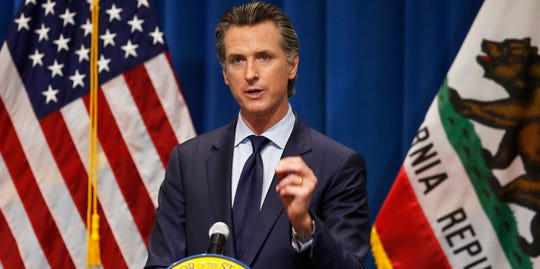 California Gov. Gavin Newsom discusses his revised 2020-2021 state budget during a news conference in Sacramento, California, May 14, 2020. It's up to Newsom whether to sign a landmark corporate diversity bill into law after it passed the state legislature in late August.