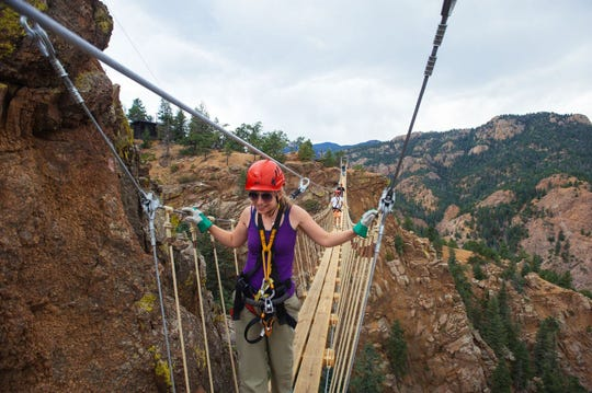 Teens and families can soar on ziplines and traverse rope bridges over canyons with The Broadmoor's Soaring Adventures.
