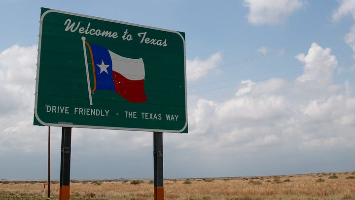 A 'Welcome to Texas' sign stands on the side of the road, May 9, 2017 near Dalhart, Texas. Tuesday was the group's second day in the field for the 2017 tornado season for their research project titled 'TWIRL.' With funding from the National Science Foundation and other government grants, scientists and meteorologists from the Center for Severe Weather Research try to get close to supercell storms and tornadoes trying to better understand tornado structure and strength, how low-level winds affect and damage buildings, and to learn more about tornado formation and prediction.