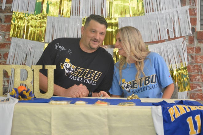 Buckeye girls basketball coach Garrett Hoffpauir (left) and Lady Panther senior Brooke Kendrick share a laugh Saturday. Kendrick signed with East Texas Baptist to continue her basketball career.