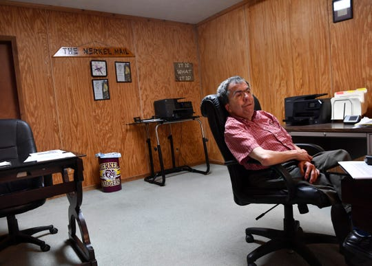 Reflecting on his nearly 30-year career in newspapering, John Starbuck leans back in his chair in the small office of the Merkel Mail Thursday.