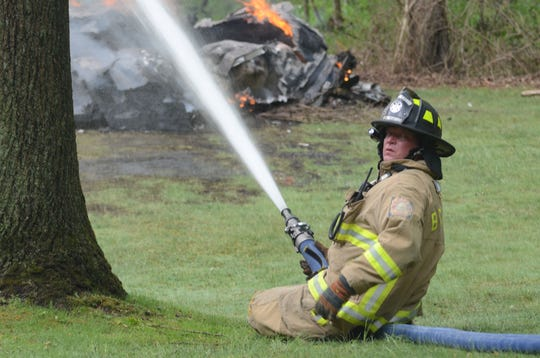 firefighters were hampered by a lack of water as they fought the Monday fire.  Trace Christenson/The Enquirer