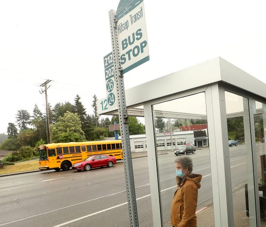 Dennis Harman prepares to board the bus at the Kitsap Transit Bus Stop in front of the R & H Market on Kitsap Way in Bremerton on May 26. Harman has a neurological disability, and riding the bus or walking are his primary ways of attending medical appointments, buying groceries and running other errands.