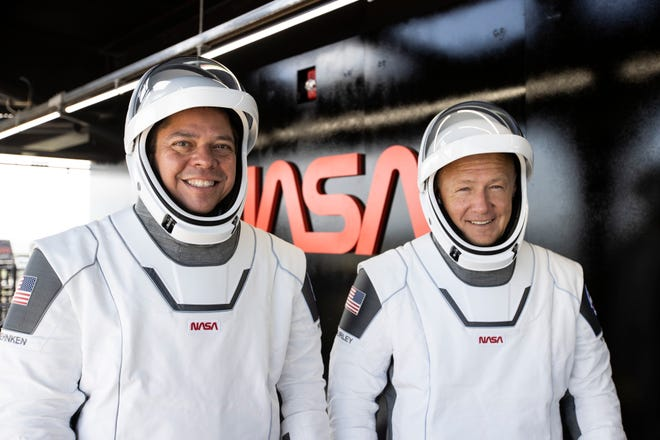 NASA astronauts Bob Behnken and Doug Hurley are seen at pad 39A's launch tower before entering the Crew Dragon capsule for rehearsals on Saturday, May 23, 2020.