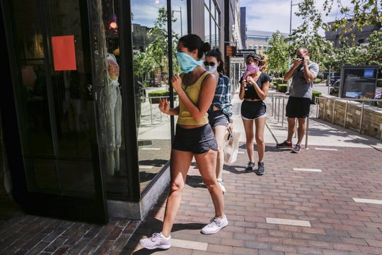 Breanna Smith, 28, shops with her friends,  Arjana Amataj, 28, Barrett Smith, 30, and Christina Garrison, 17, at the Domain North Side in Austin on May 1. Look for people crowding around entrances as a spot to avoid.