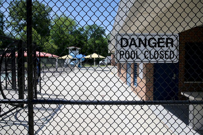 The pool and splash pad at the Oakley Recreation Center remains closed, Tuesday, May 26, 2020, in the Oakley neighborhood of Cincinnati.