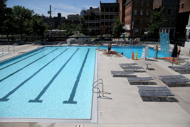 People participate in swim lessons Tuesday at Ziegler Park pool in the Over-the-Rhine neighborhood of Cincinnati. The pool, in 3CDC's Ziegler, is not part of the Cincinnati Recreation Center's programs, and is open now.