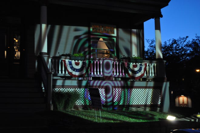 """One of the dozens of moving digital images projected onto the backstreets of Greater Cincinnati neighborhoods by Doug Borntrager and his """"Projection Connections."""" The images and the accompanying music have been contributed by artists, both local and international."""