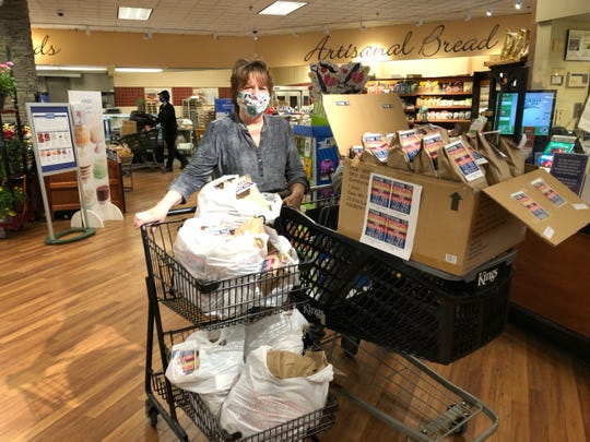 Jane Auriemma dropping off lunches and snacks to the Kings grocery store employees.