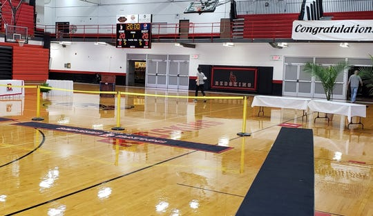 """Coshocton High School gymnasium was setup for an unique graduation ceremony that took five hours to complete. It was also memorable for Principal Grant Fauver, who spoke to each individual student. """"For me, that was special. It was something I've never experienced,"""" he said."""