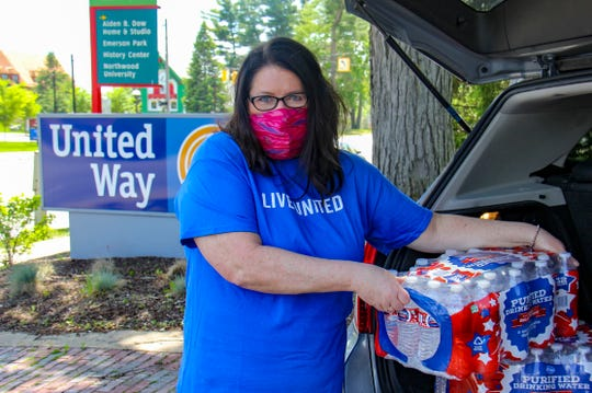Holly Miller, CEO of United Way of Midland County, is seen here unloading donated supplies at the organization's office for distribution to flood victims on Tuesday, May 26, 2020.