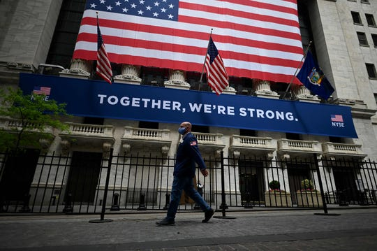 The New York Stock Exchange resumed trading on its phyiscal floor on May 26 for the first time since late March. Wall Street stocks surged early Tuesday on optimism about coronavirus vaccines, as well as an economic rebound. Analysts pointed to announcements by a number of companies pursuing vaccines for coronavirus, including Merck, which said it would acquire privately-held vaccine company Themis and disclosed new research ventures with other companies.