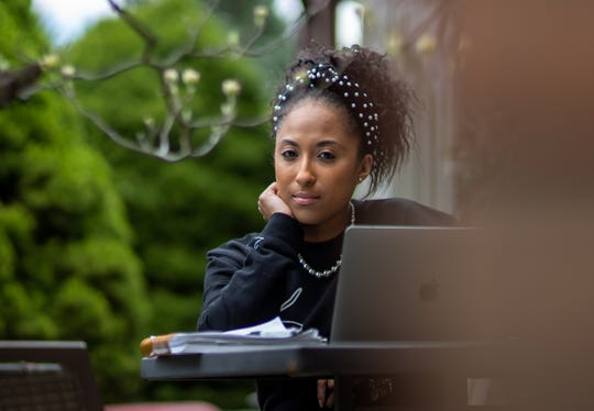 Entrepreneur Tatiana Grant of Farmington Hills is seen outside of her home on Thursday, May 7, 2020. Grant owns several businesses that have been impacted by the coronavirus including her newest venture, a marketing firm, where her partner Marlowe Stoudamire, passed away from the Coronavirus in March.