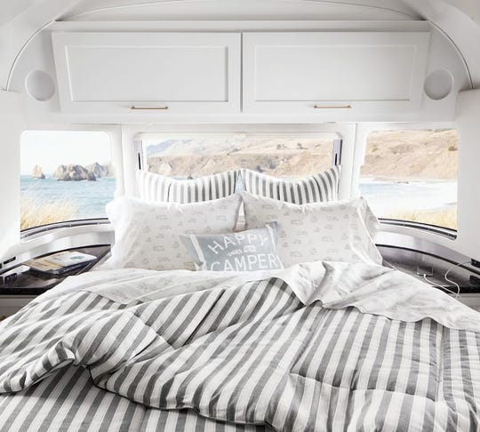 Pottery Barn debuted a new collection Airstream this month that includes bedding, pillows, tableware and art.