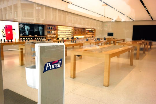 The Legacy Place Apple Store is closed out of concern about the coronavirus, in Dedham, Mass., Tuesday, March 17, 2020.