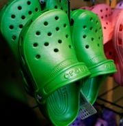 In this Feb. 6, 2006, file photo, Crocs colorful resin footwear are on display at the REI flagship store in Denver.