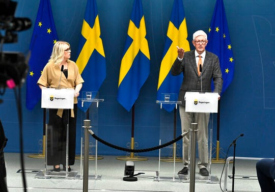 Lena Hallengren Minister for Health and Social Affairs, left, and Johan Carlson, Director General for the Swedish Public Health Agency, hold a news conference on Tuesday, May 26, 2020, about restrictions for vulnerable citizens over 70-years old in Stockholm, Sweden, Tuesday May 26, 2020.