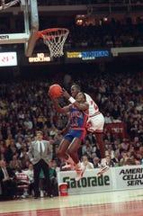 Pistons guard Isiah Thomas (11) didn't get along well with Bulls star Michael Jordan.