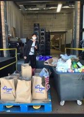 Jennifer Granger gathering food and clothing to donate to Lighthouse