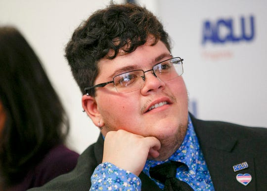 In this July 23, 2019, file photo, Gavin Grimm, who has become a national face for transgender students, speaks during a news conference held by The ACLU and the ACLU of Virginia at Slover Library in Norfolk, Va.