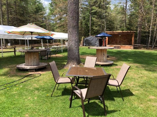 The Up North Lodge in Gwinn, Michigan has outdoor dining areas and a small stage for live music.