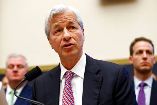 "In this April 10, 2019, file photo JPMorgan Chase chairman and CEO Jamie Dimon testifies before the House Financial Services Committee. Dimon  said Tuesday, May 26, 2020, that he sees ""pretty good odds"" of a fast economic rebound starting in the third quarter."