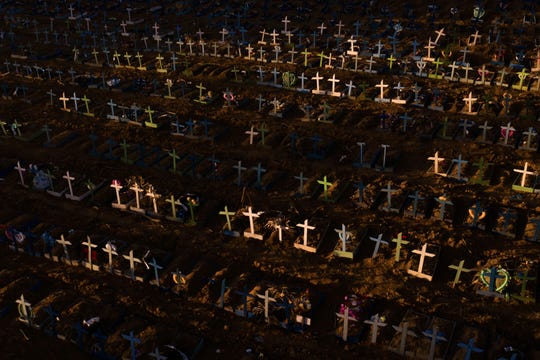 Crosses mark the graves of those who have died since early April, filling a new section of the Nossa Senhora Aparecida public cemetery amid the new coronavirus pandemic in Manaus, Brazil, Sunday, May 16, 2020. The new area was opened last month to cope with a sudden surge in deaths in the city, though most of the deceased were not tested for COVID-19.