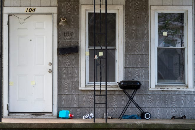 Bullet holes are marked on a house at 104 West Oregon Street in Evansville, Ind., Tuesday morning, May 26, 2020. The Evansville Police Department responded to a shooting at a house party early Tuesday morning where they found a gunshot victim, 30-year-old Larry Wayne Meriweather Jr., who later died at a local hospital as a result of his injuries.