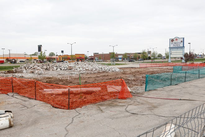 A pile of broken concrete is all that is left Friday, May 22, 2020 at the site of the former Firestone business on West Johnson Street in Fond du Lac, Wis.