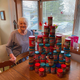 Nina Krueger poses with her birthday cards and stack of peanut butter donations for the Salvation Army of Fond du Lac County's Brown Bag Lunch program.