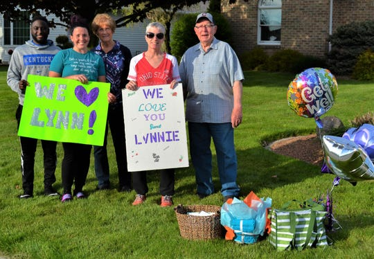 Lynn Salyer has been buoyed through her struggle with ovarian cancer by her friends and family. Here, she stands with family members amidst the gifts her friends gave her during a surprise drive-by on Friday night. From left are Salyer's son-in-law and daughter Tim and Leisha Chism; her mother Reeda Case; Salyer; and her father, Eilford Case.
