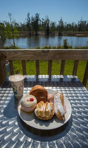 Pine Island Getaway Cafe has a great view overlooking pine trees and a small lake.