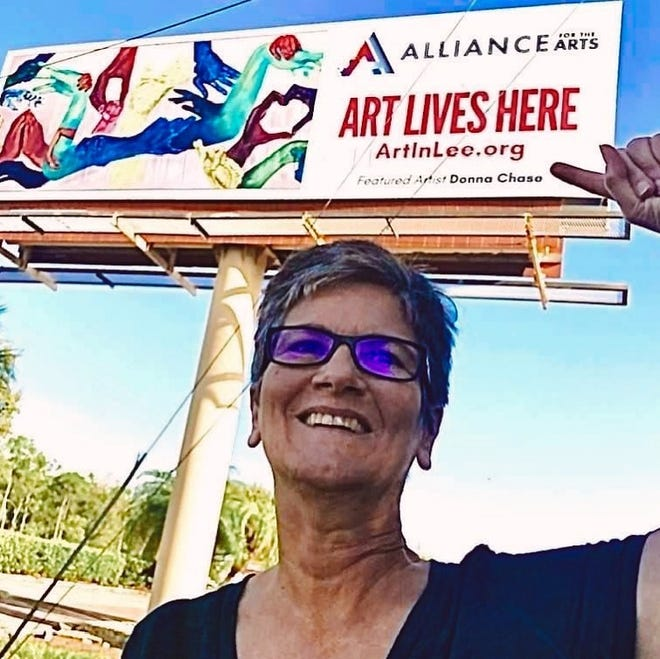 """Fort Myers artist Donna Chase poses near her painting """"Touch,"""" featured along with 11 other artists on billboards throughout Lee County."""
