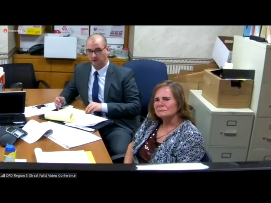 Pamela Jo Polejewski, right, sits with her attorney, Tyler Fries, during an animal cruelty hearing Tuesday, May 26, 2020. Cascade County District Judge Greg Pinski ruled that Polejewski's animal will not be returned to her at this time.