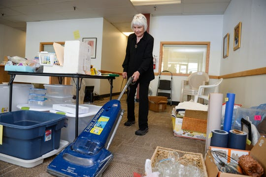 Judy Ericksen, of Gallery 16, vacuums the floors on Tuesday afternoon, May 26, 2020.  Galley 16 is closing down this week ending a 50 year run in the Great Falls community.