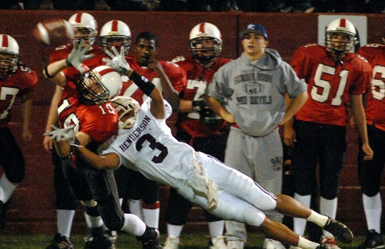 Henderson County's T.J. McElveen (3) breaks up the pass intended for Owensboro's Khiry Maddox (10) during the 2006 playoff game in Owensboro.