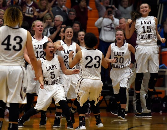 """Henderson County players from the bench celebrate as the clock winds down to """"0"""" as they defeat Webster County 42-41 in the 2016 bSecond Region championship game at Hopkinsville High School."""