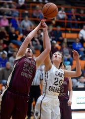 Henderson County's Emma Lander and Webster County's Hallie Gibson try to pull down a rebound during the2016 Second Region championship game at Hopkinsville High School.