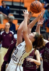 Henderson County's Emma Lander fights for a rebound during the 2016 Second Region championship game against Webster County at Hopkinsville High School.