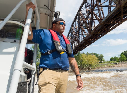 Henderson Police Department's water rescue instructor Maj. Jermaine Poynter holds on tight as he trains team members in basic boat operations, evasive maneuvers and navigational operations on the Ohio River Thursday afternoon, May 14, 2020.