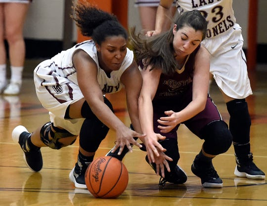 Henderson County's Alisha Owens and Webster County's Karlie Keeney dive for a loose ball during the 2016 Second Region championship game at Hopkinsville High School.