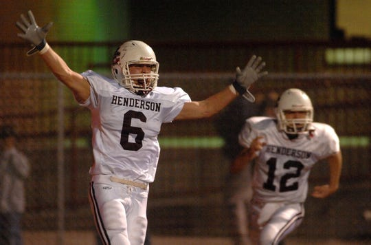 Henderson County's Elliot Geer, 6, celebrates in the end zone as Dan Thacker (12) runs up after the Colonels recovered a fumble in the end zone to score another touchdown during the 2006 playoff game against Owensboro.