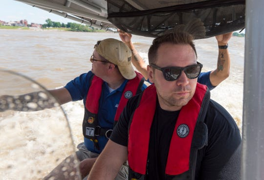 Henderson Police Department's water rescue team trains officer Kyle Stone, right, in basic boat operations, evasive maneuvers and navigational operations on the Ohio River Thursday afternoon, May 14, 2020.