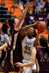 Henderson County's Alisha Owens looks for a shot while being guarded by Webster County's Hallie Gibson during the 2016 Second Region championship game at Hopkinsville High School.
