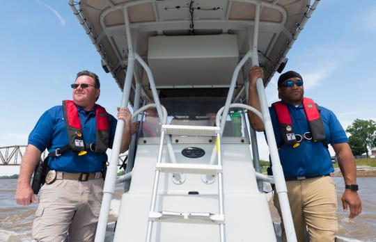 Henderson Police Department water rescue instructors Sgt. Russell Stoner, left, and Maj. Jermaine Poynter, right, work to train team members in basic boat operations, evasive maneuvers and navigational operations on the Ohio River Thursday afternoon, May 14, 2020.