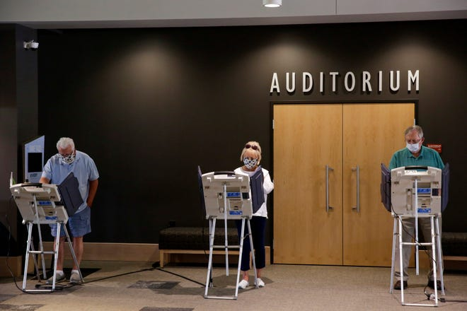Voters cast their ballots ahead of the 2020 Indiana primary at Northview Church, Tuesday, May 26, 2020 in West Lafayette. Early voting began at eight locations across Tippecanoe County including the County Office Building.