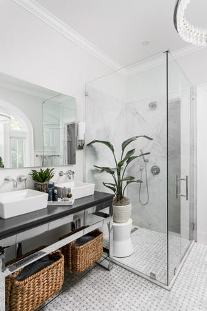 This Old Louisville bathroom remodel features book-matched Carrara marble slabs in the shower.