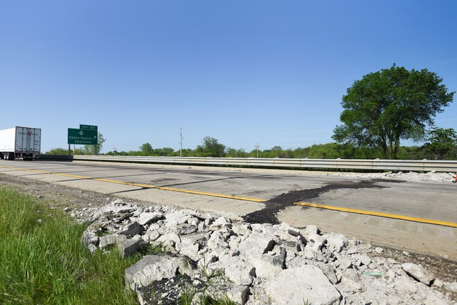 A section of southbound Interstate-69 seen patched due to buckling in the road near the M-50 exit Tuesday, May 26, 2020, near Charlotte.
